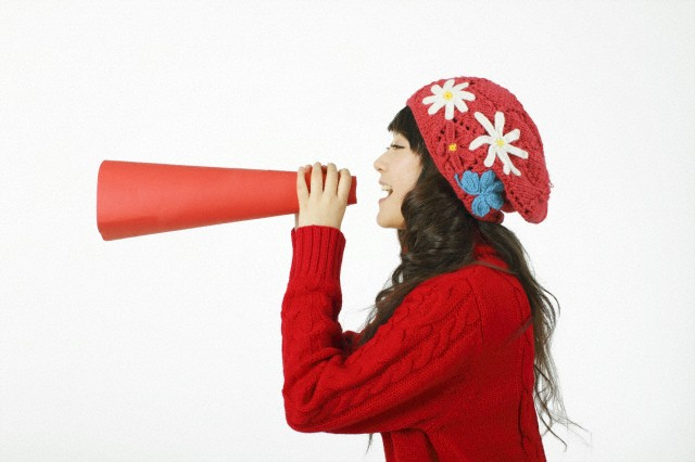 WomanAndBullHorn Why Women Need to Toot Their Own Horns at Work